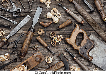 Old used woodworking tools on a vintage workbench: carpentry, craftsmanship and handwork concept