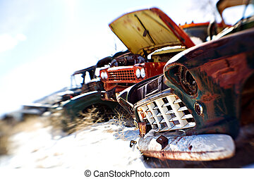 old cars at junkyard - old cars in the snow at a rural...