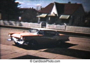 Old Cars Backing Up (1964 Vintage) - A variety of old cars...