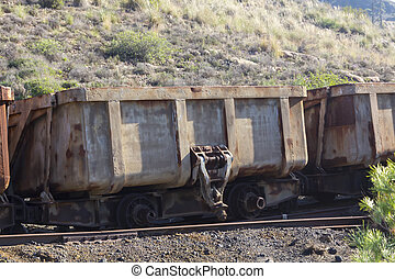 old cars in a coal mine dump with automatic system