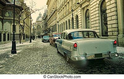 old cars in vintage scene. Bucharest city, Romania