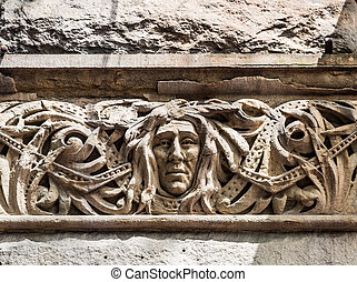 Old Carving of Face on Stone Building