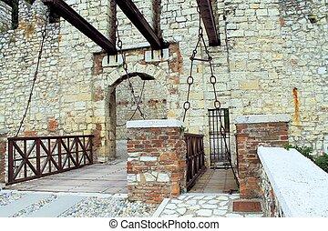 Old castle door and drawbridge & Old castle door and drawbridge.