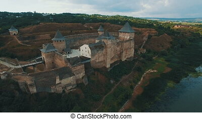 Old castle on the river bank aerial drone footage