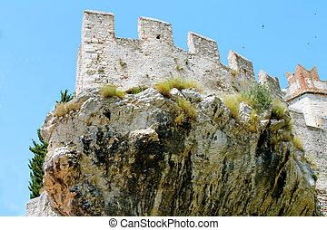 Old castle on the rock. Lake Garda