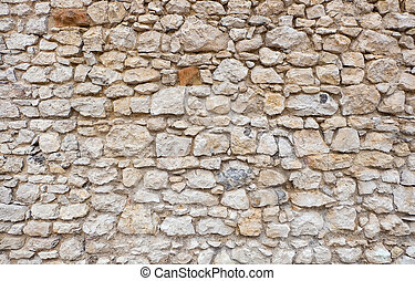old castle or fortress stone wall made of stacked stone blocks