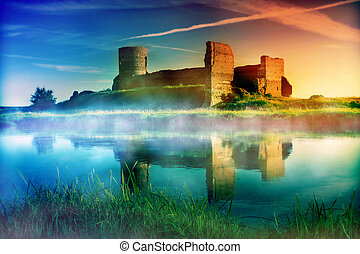 Old castle ruins at magical sunset