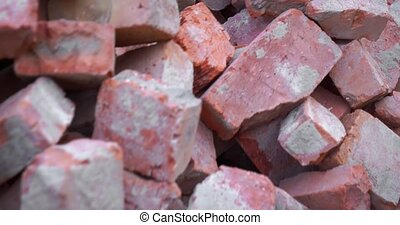 Enormous pile of red, clay brick rejects, broken and fractured in varying sizes. DCI 4k footage