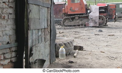 garage gate  - old caterpillar tractor and big garage gate