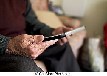 old caucasian man using a tablet