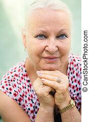 Old caucasian woman smiling at camera