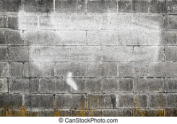 Old cement wall with spraypaint