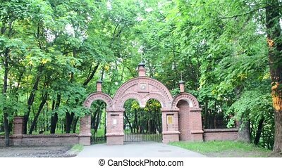 Old Cemetery gate near church in a park