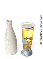 Old Ceramic Bottle and Beer in a uniqe stein glass isolated ...