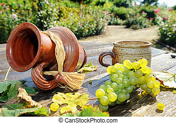 Old ceramic jug, mug and fresh grape