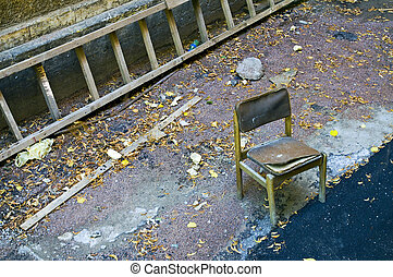 Old chair and ladder in b