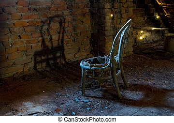 Old chair in light in a haunted house