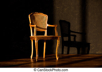 old chair on a black wall background.