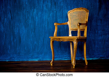 old chair on a blue wall background.