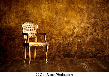 old chair on a brown wall background.