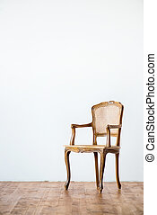 old chair on a gray wall background.