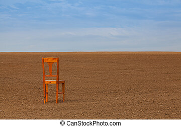 Old chair on the empty field