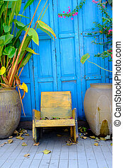 old chair with wood blue background