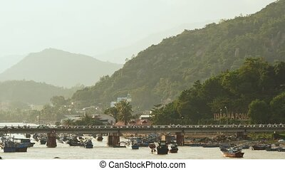 Old cham towers, bridge and boats in Nha Trang, Vietnam.
