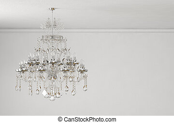 old chandelier on white wall with copy space