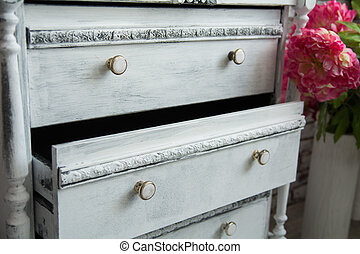 Old chest of drawers with an extended box