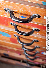 old chest of drawers with black handles