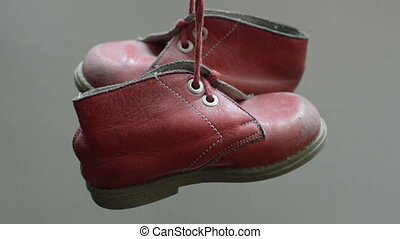 old childish shoes hang in the air - animation-old childish...