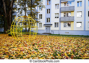 Old children playground by modern apartment house