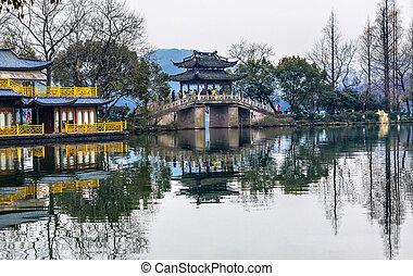 Old Chinese Bridge to Quyuan Garden Yellow Boat West Lake Hangzhou Reflection Zhejiang China .