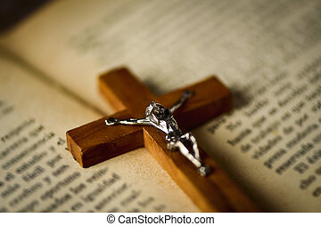 old christian crucifix on a bible
