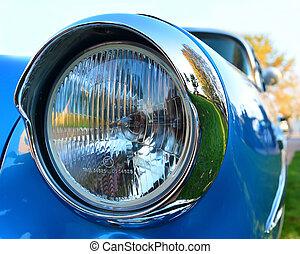old chromium-plated headlight