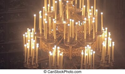 Old church candlesticks with electric candles in the Orthodox church