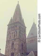 Old church in fog