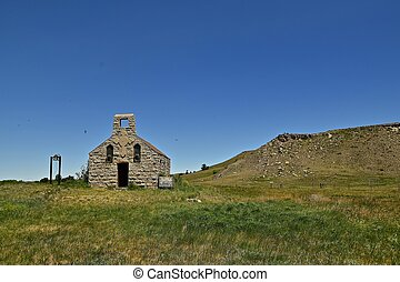 Old church in front of a butte