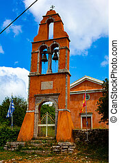 Old church in the village made of red bricks wit bells on ...