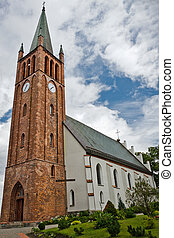 Old church made from red brick in summer