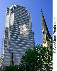 Old Church Overshadowed by a Modern Skyscraper