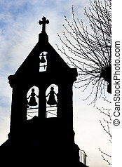 old church steeple and bells silhouette against sky