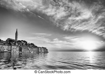 Old city core in Rovinj at sunset bw