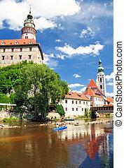 Old city in Cesky Krumlov. Vltava and castle with church