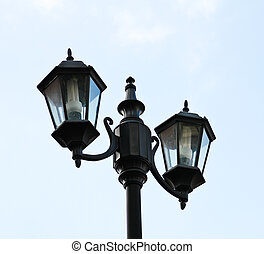 Old city lamp isolated on sky