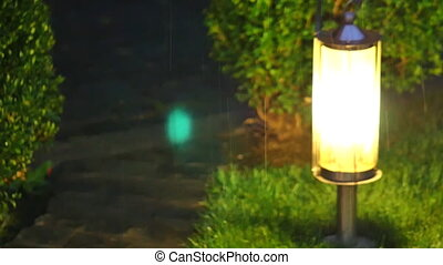 Old city lamp on rain
