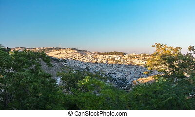 Old City of Jerusalem timelapse. Muslim Quarter, West Bank. Top view at sunset. Shadow cover hill with old buildings