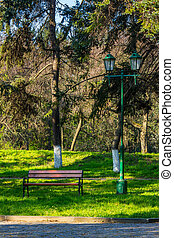 old city park with bench and lantern - area of ??the old...