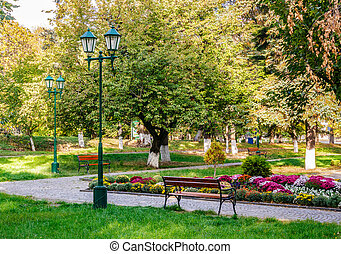 old city park with lantern - lantern near bench in empty...